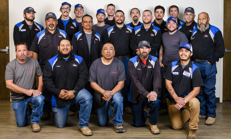 Group photo of the Comfort Masters team, including professionals in heating, air conditioning, and plumbing services, in Lubbock.
