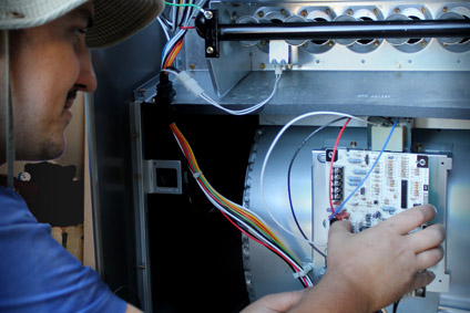 Repair technician working on a furnace